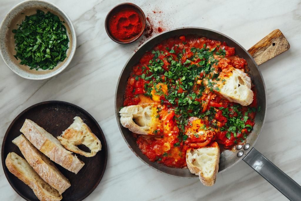 Fresh Shakshouka served in cooking pan